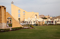 Jaipur, Rajasthan, India.  Jantar Mantar, an 18th-century Site for Astronomical Observations, now a World Heritage Site.  On the left is the Ram Yantra, to measure the altitude and azimuth of celestial objevcts.  In the background is the Vrihat Samrat Yantra, a sundial.