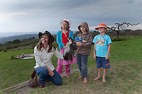 Shannon Hoffman posing with a Lanner Falcon and genuinely interested school children, after a flight display show. The shows are aimed at educating children and adults and have a strong conservation message..October 2010..African Bird of Prey Sanctuary..Kwazulu-Natal, South Africa.