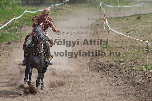 Mihai Cozmei of Romania rides his horse during the European Open Championship of Horseback Archery in Veroce, about 60 km (37 miles) north of the capital Budapest, Hungary on August 31, 2012. ATTILA VOLGYI