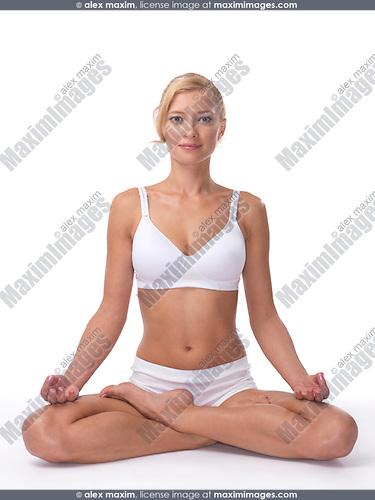 Young woman meditating in Lotus pose