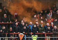 Blackpool fans suffer after a smoke bomb is let off at  Highbury Stadium, home of Fleetwood Town<br /> Photographer Lee Parker/CameraSport<br /> <br /> The EFL Sky Bet League One - Fleetwood Town v Blackpool - Saturday 7th March 2020 - Highbury Stadium - Fleetwood<br /> <br /> World Copyright © 2020 CameraSport. All rights reserved. 43 Linden Ave. Countesthorpe. Leicester. England. LE8 5PG - Tel: +44 (0) 116 277 4147 - admin@camerasport.com - www.camerasport.com