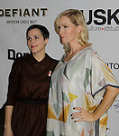 Jennie Garth (90210, Melrose Place) poses with designer Katty Xiomara after her Runway Show presented by RUSK during the fall/winter 2014 Nolcha Fashion Week - spotlighting independent designers on February 12, 2014 at Pier 59, New York City, New York.  (Photo by Sue Coflin/Max Photos)