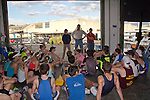 Rowing, Seattle, Seattle Rowing Center, rowing schools, middle school, high school rowers listening to coach Conal Groom after an afternoon workout