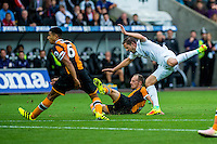 Gylfi Sigurdsson of Swansea City  takes a fall during the Premier League match between Swansea City and Hull City at the Liberty Stadium, Swansea on Saturday August 20th 2016