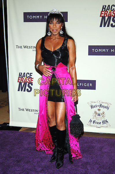 NATALIE COLE<br /> 12th Annual Race to Erase MS, Century Plaza Hotel, Century City, California, USA, <br /> April 22nd 2005.<br /> full length black dress fucshia pink skirt knee high boots tiara earrings dangly diamante silver<br /> Ref: ADM<br /> www.capitalpictures.com<br /> sales@capitalpictures.com<br /> &copy;J Wong/AdMedia/Capital Pictures