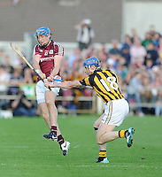 28th June 2014; Conor Cooney of Galway has his shot blocked by Kilkenny's Brian Hogan. GAA Hurling Senior Championship Semi-Final replay Kilkenny v Galway, O'Connor Park, Tullamore. Picture credit: Tommy Grealy/actionshots.ie.