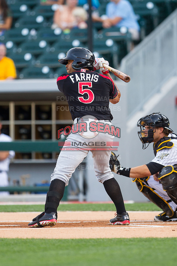 Eric Farris (5) of the Rochester Red Wings at bat against the Charlotte Knights at BB&T Ballpark on June 5, 2014 in Charlotte, North Carolina.  The Knights defeated the Red Wings 7-6.  (Brian Westerholt/Four Seam Images)