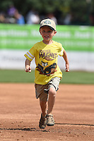 Kane County Cougars young fan runs the bases for an on field promotion during a game against the Quad Cities River Bandits on August 20, 2014 at Third Bank Ballpark in Geneva, Illinois.  Kane County defeated Burlington 7-3.  (Mike Janes/Four Seam Images)