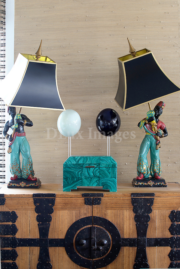 Lampshades on a wooden sideboard
