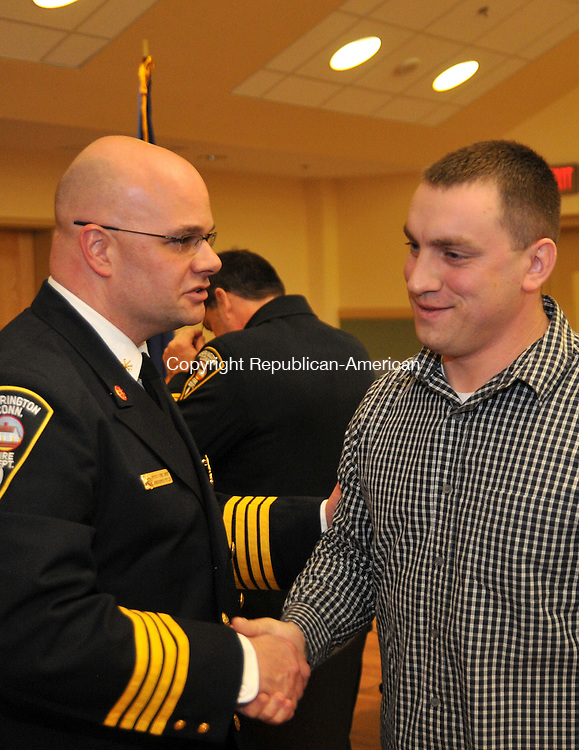 TORRINGTON, CT, 04 MARCH 15 - Torrington firefighter Robert Shopey is congratulated by Deputy Chief Christopher Pepler on his promotion to lieutenant Wednesday. Alec Johnson/ Republican-American
