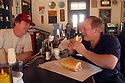 Parkway Tavern and Bakery owner Jay Nix chats with customer Bruce Feingerts at the bar, while lunching on an oyster poboy, Wednesday, March 23, 2005..(Cheryl Gerber Photo)