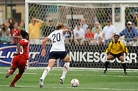 Abby Wambach (20) of the United States (USA) moves in on goalkeeper Karina LeBlanc (1) of Canada (CAN). The United States (USA) Women's National Team defeated Canada (CAN) 1-0 during an international friendly at Marina Auto Stadium in Rochester, NY, on July 19, 2009.