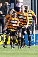 Luke Gambin of Barnet (left) celebrates scoring the opening goal against Luton Town during the Sky Bet League 2 match between Barnet and Luton Town at The Hive, London, England on 28 March 2016. Photo by David Horn.