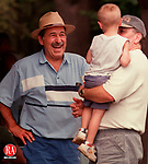 PROSPECT, CT 08/09/98 --0809jh05.tif-- Skip Jannetty of Waterbury, left, enjoys visiting with Bill Mullen of Prospect and his grandson Andrew Mullen, 3-and-a-half, of Waterbury, during the first annual family picnic held by the Waterbury Ancient Order of Hibernians Sunday at the V.F.W. Grove in Prospect. About 300 attended the event, which featured a pig roast, games, and entertainment. JOHN HARVEY staff photo STANDALONE PHOTO.