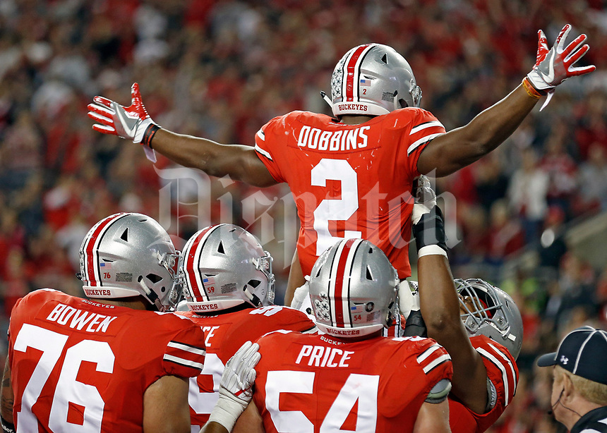 Ohio State Buckeyes running back J.K. Dobbins (2) celebrates after scoring a rushing touchdown against Oklahoma Sooners during the 2nd half at Ohio Stadium in Columbus, Ohio on September 9, 2017. [Kyle Robertson/Dispatch]