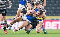 Picture by Allan McKenzie/SWpix.com - 19/04/2018 - Rugby League - Betfred Super League - Hull FC v Leeds Rhinos - KC Stadium, Kingston upon Hull, England - Leeds's Kallum Watkins is tackled by Hull FC's Scott Taylor.