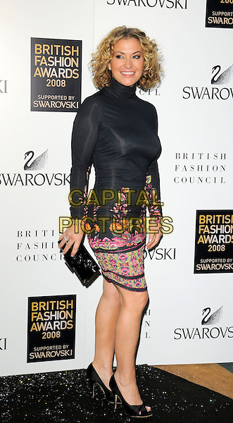 LOUISE FOE.Inside arrivals at the British Fashion Awards 2008 held at The Lawrence Hall in London, England. UK, .November 25th 2008.full length black polo neck curly hair bob dress tight floral print red pink trim long sleeves sleeved open toe shoes clutch bag .CAP/CAN.©Can Nguyen/Capital Pictures.