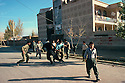 Iran 1979.Young Kurds and pasdarans playing football in front the headquarter of pasdarans in Mahabad
