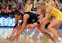 16.09.2012 Silver Ferns Maria Tutaia and Australian Julie Corletto in action during the first netball test match between the Silver Ferns and the Australian Diamonds played at the Hisense Arena In Melbourne. Mandatory Photo Credit ©Michael Bradley.