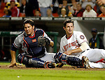 15 September 2007: Atlanta Braves catcher Corky Miller (left) misses tagging Austin Kearns (right) during game action against the Washington Nationals at Robert F. Kennedy Memorial Stadium in Washington, DC. The Nationals defeated the Braves 7-4 in the second game of their 3-game series...Mandatory Photo Credit: Ed Wolfstein Photo