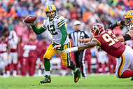 Landover, MD - September 23, 2018: Green Bay Packers quarterback Aaron Rodgers (12) avoids tackle by Washington Redskins defensive end Jonathan Allen (93) during game between the Green Bay Packers and the Washington Redskins at FedEx Field in Landover, MD. The Redskins get the win 31-17 over the visiting Packers. (Photo by Phillip Peters/Media Images International)