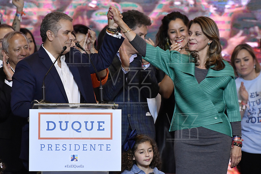 BOGOTA - COLOMBIA, 17-06-2018: Ivan Duque, presidente electo y candidato presidencial por el partido Centro Democrático, acmpañado de su vicepresidente, Martha Lucia Ramirez, durante su alocución al finalizar la segunda vuelta de las elecciones presidenciales de Colombia 2018 hoy domingo 17 de junio de 2018. El candidato ganador gobernará por un periodo máximo de 4 años fijado entre el 7 de agosto de 2018 y el 7 de agosto de 2022. / Ivan Duque, elected president and presidential candidate for the Centro Democratico party, and his vice president, Martha Lucia Ramirez, during his speech after Colombia's second round of 2018 presidential election today Sunday, June 17, 2018. The winning candidate will govern for a maximum period of 4 years fixed between August 7, 2018 and August 7, 2022. Photo: VizzorImage / Gabriel Aponte / Staff