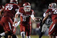 NWA Media/ J.T. Wampler - Arkansas' Austin Allen makes a hand off to Jonathan Williams during the Hogs' 30-0 shutout of Ole Miss Saturday Nov. 22, 2014.