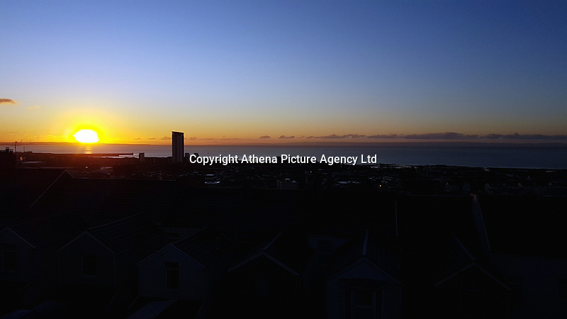 FROSTY WEATHER WALES<br /> Frost on roof tops of houses in Mount Pleasant starts thawing as the the sun rises over Swansea Bay. Wednesday 29 November 2017