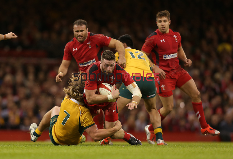 Australian flanker Michael Hooper hauls down Wales wing Alex Cuthbert.<br /> Dove Men Series 2014<br /> Wales v Australia<br /> Millennium Stadium<br /> 08.11.14<br /> ©Steve Pope-SPORTINGWALES