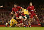 Australian flanker Michael Hooper hauls down Wales wing Alex Cuthbert.<br /> Dove Men Series 2014<br /> Wales v Australia<br /> Millennium Stadium<br /> 08.11.14<br /> &copy;Steve Pope-SPORTINGWALES