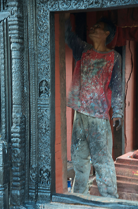 Restoring small temple at Pashupatinath Cremation and Temple Area in Kathmadu, Nepal