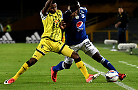 BOGOTA - COLOMBIA - 22 - 03 - 2018: Eliser Quiñonez (Der.) jugador de Millonarios disputa el balón con Yhorman Hurtado (Izq.) jugador de Alianza Petrolera, durante partido aplazado de la fecha 8 entre Millonarios y por la Liga Aguila I 2018, jugado en el estadio Nemesio Camacho El Campin de la ciudad de Bogota. / Eliser Quiñonez (R) player of Millonarios vies for the ball with Yhorman Hurtado (L) player of Alianza Petrolera, during a posponed match of the 8th date between Millonarios and Alianza Petrolera, for the Liga Aguila I 2018 played at the Nemesio Camacho El Campin Stadium in Bogota city, Photo: VizzorImage / Luis Ramirez / Staff.