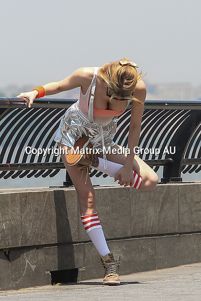 3 JUNE 2014 NEW YORK USA<br /> <br /> EXCLUSIVE PICTURES<br /> <br /> Its not Brynne 2.0 Its Gabi Greko 1.0 pictured stretching by the Hudson River after a jog. Gabi was spotted getting physical with a more 'natural' look without her 'alter ego' wig and vamp makeup but in the usual unique style we have come to expect since she first broke onto the social scene two weeks before. Hitting the street in silver hot pants held up with some braces and long pulled up socks Gabi turned heads as she relaxed to drink some water and picked up some items from a vintage clothing store on her way home.
