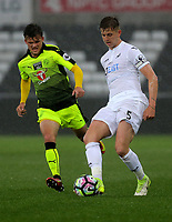Pictured: (L-R) Tyler Frost of Reading puts pressure on Keston Davies of Swansea City Monday 15 May 2017<br /> Re: Premier League Cup Final, Swansea City FC U23 v Reading U23 at the Liberty Stadium, Wales, UK