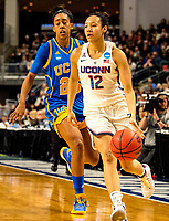 3/25/17 Bridgeport, Ct.  NCAA sweet sixteen, Saniya Chong [#12] beats her opponent for two of her 16 points as UCONN rolls easily 86-71 and advances to the quarters on Monday.