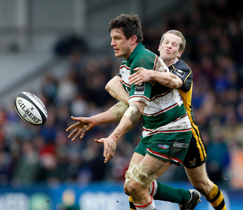 Photo: Richard Lane/Richard Lane Photography..Leicester Tigers v London Wasps. Guinness Premiership. 29/03/2008. Tigers' Martin Corry passes as Wasps' Dave Walder tackles.