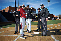 Wake Forest Demon Deacons head coach Tom Walter (16) explains the ground rules to Gardner-Webb Runnin' Bulldogs head coach Rusty Stroupe (7) and umpires Tony Carilli (right), Danny Collins (middle) and Jamie Roebuck (left) at David F. Couch Ballpark on February 18, 2018 in  Winston-Salem, North Carolina. The Demon Deacons defeated the Runnin' Bulldogs 8-4 in game one of a double-header.  (Brian Westerholt/Four Seam Images)