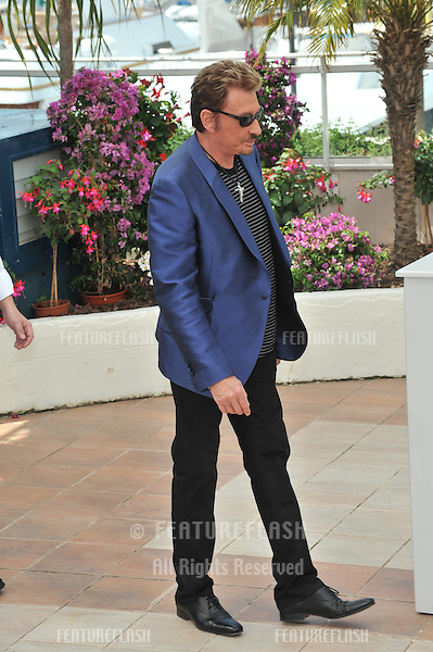 "French superstar Johnny Hallyday  at the photocall for his new movie ""Vengeance"" which is in competition at the 62nd Festival de Cannes..May 17, 2009  Cannes, France.Picture: Paul Smith / Featureflash"