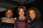 """Deb Koenigsberger (event chair) - Countess LuAnn de Lesseps (presenter) - Tamara Tunie mistresses of ceremonies of The Fourteenth Annual Hearts of Gold Gala """"Hooray for Hollywood!"""" - with its mission to foster sustainable change in lifestyle and levels of self-sufficiency for homeless mothers and their children on October 28, 2010 at the Metropolitan Pavillion, New York City, New York. (Photo by Sue Coflin/Max Photos)"""