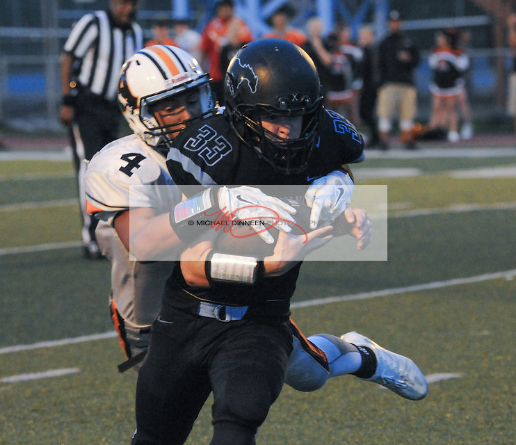 Bryant White is caught by West''s Blake Despain at Chugiak Friday, August 27, 2016.  Photo for the Star by Michael Dinneen