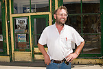 Dean Coombs, third generation newspaperman and printer at the Saguache Crescent Newspaper, last of the hot metal newspapers in the U.S. in front of the Newpaper offices