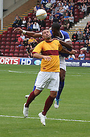 Michael Higdon and Victor Anichebe duel in the air in the Motherwell v Everton friendly match at Fir Park, Motherwell on 21.7.12 for Steven Hammell's Testimonial.