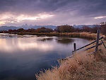 Idaho, Eastern, Teton Valley, Driggs. The Teton River and Range in the Morning twilight of autumn.
