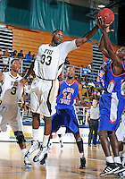 Florida International University guard Tola Akomolafe (33) plays against Florida Memorial University in an exhibition game .  FIU won the game 86-69 on November 9, 2011 at Miami, Florida. .
