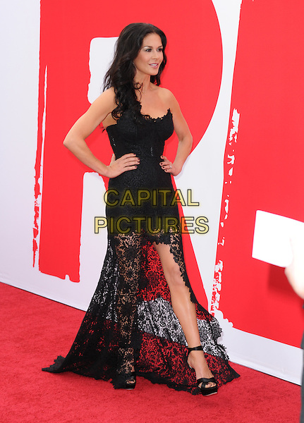 Catherine Zeta-Jones <br /> at The Summit Entertainment L.A. Film Premiere of &quot;Red 2&quot; held at Westwood Village in Westwood, California, USA, July 11th 2013.<br /> full length strapless black lace side dress long maxi slit split zeta jones                                             <br /> CAP/DVS<br /> &copy;Debbie VanStoryCapital Pictures