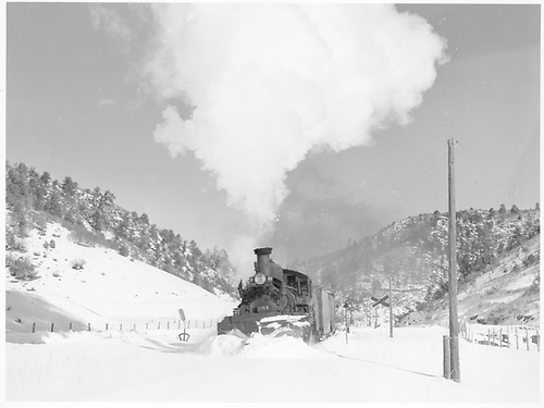 Leased D&amp;RGW #464 plows through snow northbound past Porter on 12-17-1951.<br /> RGS  Porter, CO  Taken by Richardson, Robert W. - 12/17/1951
