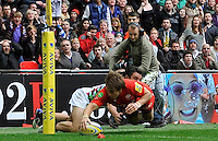 London, England.George Lowe of Harlequins stops Chris Wyles of Saracens from scoring a try during the Saracens and Harlequins Aviva Premiership with a world record crowd of 83,761 for a club rugby match at Wembley Stadium. 31March 2012 at Wembley Stadium, London, England,