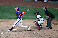 Shortstop Logan Davidson (8) of the Clemson Tigers hits a two-run home run in the eighth inning of the Reedy River Rivalry game against the South Carolina Gamecocks on Saturday, March 2, 2019, at Fluor Field at the West End in Greenville, South Carolina. Clemson won, 11-5. (Tom Priddy/Four Seam Images)
