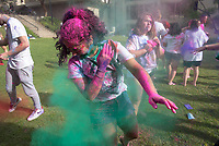 "The Occidental South Asian Students Association brought the Holi festival to campus with joy and colors for all. From SASA: ""Holi is a Hindu festival that marks the arrival of spring, the victory of good over evil, and a day of joyful celebration with friends & family.""<br /> March 30, 2018 on the lawn between Herrick and the Library.<br /> (Photo by Marc Campos, Occidental College Photographer)"