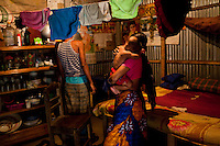 "Nargis Akhter takes care of her 7 month old son Nahid Hassan in her home compound in Gazipur village, Upazila Sreepur, Gazipur, Bangladesh on 21st September 2011. Nargis, now aged 19, was pulled our of school and wed when she was 12 years old as her family was afraid that she might become a victim of severe eve-teasing. Sad to leave school, she recalls being 'terrified, sad and uncertain' on the day of her marriage. Being married off at such a young age ""is not good for health,"" she says. Her first baby died soon after birth and she is now raising her 2nd child. Photo by Suzanne Lee for The Guardian"